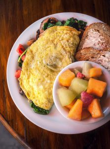 Egg Stuffed With Vegetables Omelet for Breakfast, Fruit, and Toast